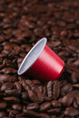 Coffee pod on a bed of coffee beans Royalty Free Stock Photo