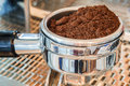 Coffee portafilter filled with finely grounded coffee Royalty Free Stock Image