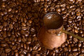 Coffee pot on beans Stock Images