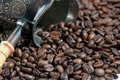 Coffee pot with coffee beans Royalty Free Stock Images