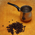 Coffee pot and coffee beans Royalty Free Stock Images