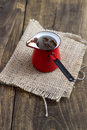 Coffee pot red on old wooden table Stock Image