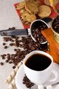 Coffee pot, sweets, cup and grinder Stock Photos