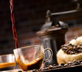 Coffee poured into a glass cup in a café setting in ancient Stock Photos
