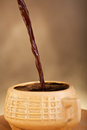 Coffee pouring into cup Stock Photos