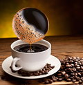 Coffee pours into the cup. Royalty Free Stock Images