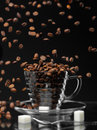 Coffee rain coffe beans are falling down to the cup Stock Photos
