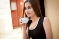 Coffee refreshment beautiful young woman having some Royalty Free Stock Image