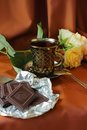 Coffee roses and chocolate cup of bar Royalty Free Stock Photography
