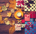 Coffee and season gifts with leafs cup of on wooden background Royalty Free Stock Images