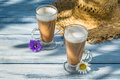 Coffee served in the sunny garden on old wooden table Stock Photo