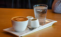 Coffee a set of with a glass of water Royalty Free Stock Photography