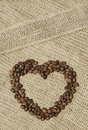 Coffee shaped heart on canvas Stock Images