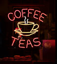 Coffee sign a red and yellow neon reading teas Royalty Free Stock Images