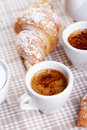 Coffee sill life still with croissant over fabric background Stock Photos
