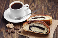 Coffee and slice buns with poppy cup of on wooden table Royalty Free Stock Photos