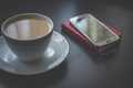 Coffee and smartphone on schedule Royalty Free Stock Photo