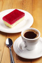 Coffee and strawberry cake cup of with poppy on wooden table Royalty Free Stock Photo