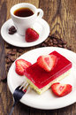 Coffee and strawberry cake cup of with poppy on wooden table Royalty Free Stock Photos