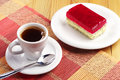Coffee and strawberry cake with poppy cup of on colorful bamboo napkin Stock Photos