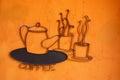 Coffee symbol on orange wall Stock Photography