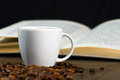 Coffee on the table and reading book black strong Stock Photo