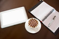 Coffee table surface tablet pc with fresh cup of view from above Stock Photography