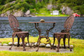 Coffee table with two chairs outdoor near lake Royalty Free Stock Photo