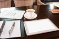 Coffee and tablet pc office supplies on the table Royalty Free Stock Photo