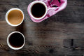 Coffee take away. Coffee cups with covers on wooden table backound top view copyspace