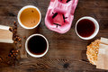 Coffee take out. Coffee cups with covers, coffee beans and cookies on wooden table backound top view copyspace