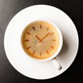 Coffee time cup of fresh espresso with clock sign view from above Royalty Free Stock Image