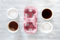 Coffee to go. Coffee cups with cover on wooden table backound top view