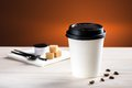 Coffee to go on white table Stock Photo