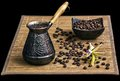 Coffee turk with coffee beans and orchid Royalty Free Stock Photography
