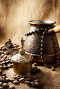 Coffee turk still life on a sackcloth background Stock Photos