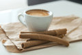 Coffee and wafer tubes Royalty Free Stock Photo