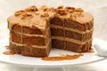 Coffee walnut layer cake on white plate Royalty Free Stock Photo