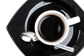 Coffee in white cup on black saucer Royalty Free Stock Images