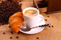 Coffee in white cup and croissant close up Stock Photo