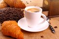 Coffee in white cup, grinder and croissant Royalty Free Stock Photo