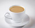 Coffee in a white cup on a white background the table Royalty Free Stock Images