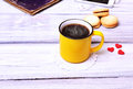 Coffee in a yellow mug Royalty Free Stock Photo