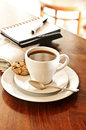 Coffeebreak with nwewspaper Stock Photography