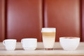 Coffees displayed on table variety of at cafe Royalty Free Stock Images