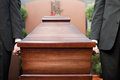 Coffin bearer carrying casket at funeral Royalty Free Stock Photo