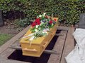 Coffin before burial with flowers on it Royalty Free Stock Photos