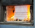 Coffin in cremation burning with flame Stock Image