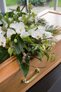 Coffin in morgue a with a flower arrangement a Stock Photography