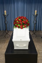 Coffin in morgue a with a flower arrangement a and a burning candle front Royalty Free Stock Photos